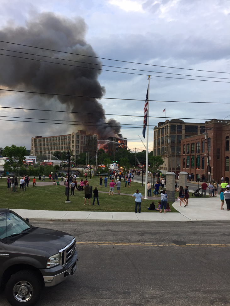 photo of onlookers watching a mill fire