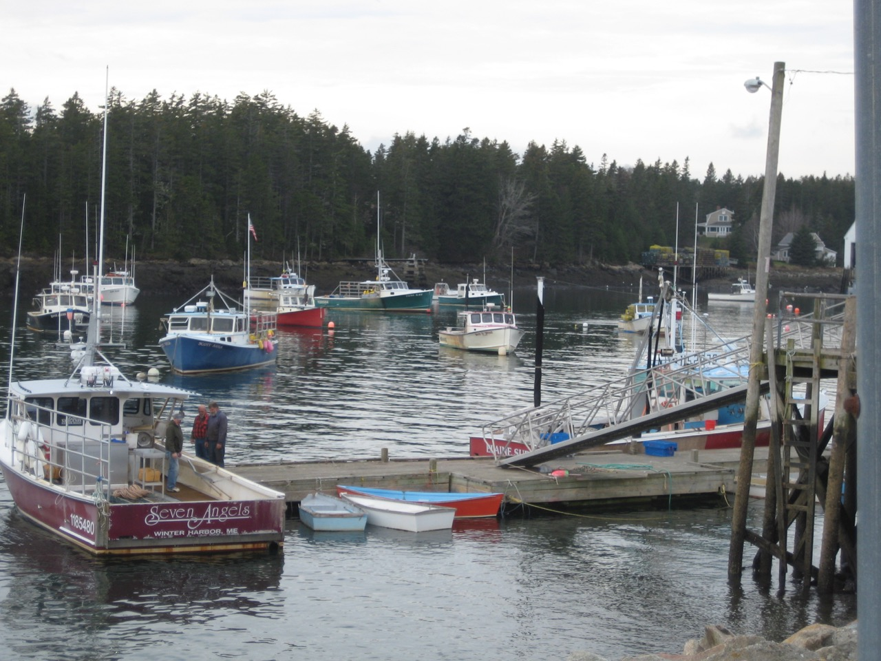 a photo of several boats docked in a harbor